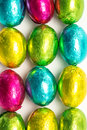 Colourful foil wrapped easter eggs overhead shot green yellow pink blue Royalty Free Stock Photos