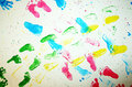 Colourful foot prints on white copy space Stock Photo