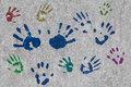 Colourful handprints on a wall Royalty Free Stock Photography