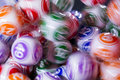 Colourful lottery balls in a machine Royalty Free Stock Photo