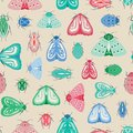 Colourful moths and beetles seamless repeat pattern. A vector design of insects and bugs. Royalty Free Stock Photo