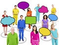 Colourful multi ethnic people with speech bubbles group of and a theme of connection for copy space Stock Photo