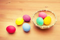 Colourful painted easter egg and basket on the table Stock Images