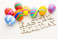 Colourful pattern easter egg with wooden text Stock Photography