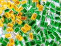 Colourful plastic granules green and yellow Stock Images