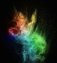 Colourful powder exploding isolated on black Stock Photography