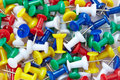 Colourful push pins background many Stock Photography
