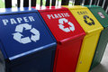Colourful recycle bins go green do not litter Stock Images