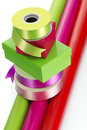 Colourful ribbon boxes and gift wrap bright coloured stacked on wrapping paper Stock Images