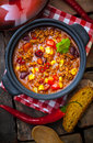 Colourful rich lentil and vegetable stew overhead view of a pot of with peppers corn carrots lentils in a ountry kitchen Royalty Free Stock Photography