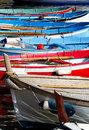 Colourful rowboats row of used for fishing Stock Images