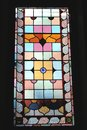 Colourful stained glass window, isolated on black Royalty Free Stock Images