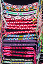Colourful straps laying and thongs found at market place in indonesia pink blue black brown macroperspective background Stock Image