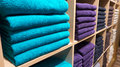 Colourful towels on the shelves in the store Royalty Free Stock Image