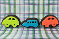 Colourful toy car stamps cute on funky patterned background Stock Photo