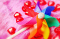 Colourful toy pinwheel with hearts Royalty Free Stock Images