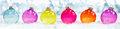 Colourful translucent Christmas baubles Royalty Free Stock Photo