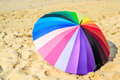 Colourful umbrella and sand background Royalty Free Stock Photo