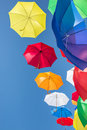 Colourful umbrellas against a blue sky bright Royalty Free Stock Photo