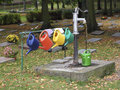 Colourful watering cans on a cemetery Royalty Free Stock Photos