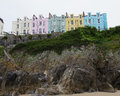 Colourfull houses on boulevard of tenby high cliff in pembrokeshire wales Royalty Free Stock Images
