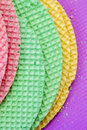 Colourfull waffles. Textured abstract background. Close up. Flat lay