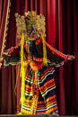 A colourfully costumed Mask Dancer performs at the Esala Perahara theatre show in Kandy, Sri Lanka. Royalty Free Stock Photo