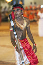 A colourfully dressed Stick dancer performs in the Kataragama Festival in Sri Lanka. Royalty Free Stock Photo
