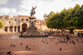 Columbus monument on the square full of pigeons Stock Images