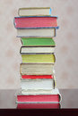 A column of hardback colorful closed books on table Stock Images