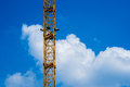 Column of tower crane main against the background white cloud and blue sky Stock Photo