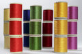 Columns of bobbins of cotton thread several for sewing machines with the colors rainbow Stock Photo
