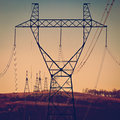Columns high voltage power photographed in daylight. Royalty Free Stock Photo