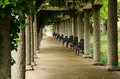 Columns of italian pergola at maymont gardens wrought iron chairs line the in richmond virginia Royalty Free Stock Images