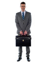 Comany's CEO holding his handbag Royalty Free Stock Image