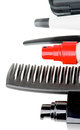 Comb and hair styling products frame of black various curling isolated on white background Royalty Free Stock Photo