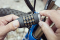 Combination lock bike accessory locking a bicycle Royalty Free Stock Photo