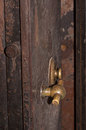 Combination lock and handle on an antique safe door Stock Image