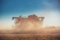 Combine harvester agriculture machine harvesting golden ripe whe Royalty Free Stock Photo