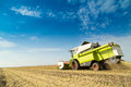 Combine harvester harvesting soybean at field Royalty Free Stock Photo