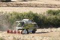 Combine harvester working in a wheat field on a summer day Royalty Free Stock Photography