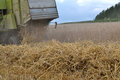 Combine throws straw out Royalty Free Stock Photo