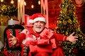 Come here. Merry christmas. Grandpa at home. Traditions concept. Santa Claus near christmas tree. Bearded senior man Royalty Free Stock Photo