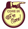 Come in, we are open! Door shop welcoming sign with pointing finger Royalty Free Stock Photo