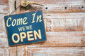 Come in we re open on the wooden door copyspace on the right Stock Photography