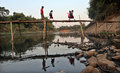 Come school number of students crossing the bamboo bridge river river solo in the morning after a holiday students Stock Photo