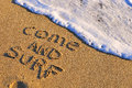 Come and surf sign on the beach Stock Images