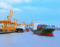 Comercial ship with container on shipping port for import export and logistic transportation Royalty Free Stock Image