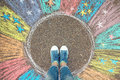 Comfort zone concept. Feet standing inside comfort zone circle. Royalty Free Stock Photo