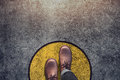 Comfort Zone concept, Male with leather shoes steps over circle Royalty Free Stock Photo